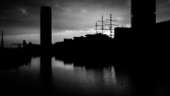 Early One Morning (Sean Batten) Tags: london england unitedkingdom gb fuji x100f fujifilm blackandwhite city skyline eastlondon canarywharf docklands urban reflection water buildings