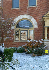 Window, Bush House — Lexington, Kentucky (Pythaglio) Tags: lexington kentucky unitedstates us fayettecounty twostory brick ornate romanesque 1889 asymmetry queenanne latevictorian porch rusticated stonework roundarched stainedglass cornice brackets bush sidewalk bushes snow