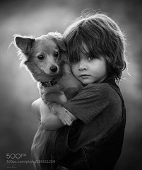 Friends (hoangcuongnokia8800) Tags: 500px child dog friends monochome jessica drossin wwwjessicadrossincom wbpa kid boy freckles eyes black white overalls close up face fur pet love