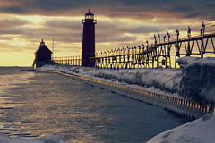 Winter Light Ahead (matthewkaz) Tags: catwalk silhouette pier lighthouse grandhavenlighthouse grandhaven lakemichigan lake water greatlakes ice snow winter sunset frozen sky clouds reflection reflections michigan 2016