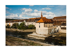 Sunny Wharf (Thomas Listl) Tags: thomaslistl color würzburg urban wharf river water waterscape main facade architecture sunny evening summer september sky blue vivid saturated grain roof bridge 35mm ngc