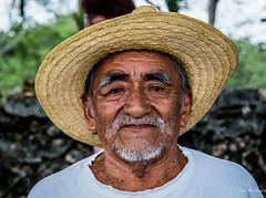 2018 - Mexico - Hacienda Sotuta de Peón - Mayan Señor - 1 of 2 (Ted's photos - Returns late Feb) Tags: 2018 cropped haciendasotutadepeón mexico nikon nikond750 nikonfx tedmcgrath tedsphotos tedsphotosmexico vignetting yucatan beard hat strawhat face pose posing portrait man moustache bokeh nationalgeographicfacesoftheworld