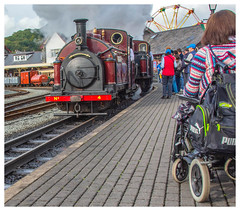Ffestiniog Railway Porthmadog (tramsteer) Tags: tramsteer transport wheelchairs disabled platform station steamtrain smoke steam ffestiniog fairground wheel outdoors clouds sky railway geotag