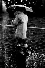 On the Christmas lights (pascalcolin1) Tags: paris13 femme woman nuit night pluie rain reflets reflection manteau coat parapluie umbrella christmas noel lumières lights chaussettes socks photoderue streetview urbanarte noiretblanc blackandwhite photopascalcolin 50mm canon50mm canon
