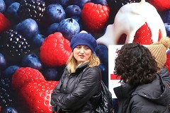 Blueberry beret.... (markwilkins64) Tags: streetphotography street candid fruit blueberry blackberry strawberry hats hat shopwindow markwilkins mark lady ladies autumn cold streetportrait browneyes london strand uk smile humour cream beret