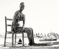 Man and Mermaid (photoday03) Tags: man mermaid spezia bn sea nikon statues sky waterfront outdoor water