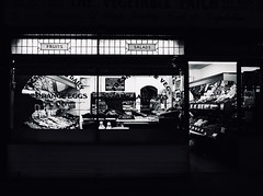 IMG_1120590 (Kathi Huidobro) Tags: victorianwindows afterdark openlate shopfront grocerystore groceries highcontrast nightshoots nightlights blackwhite bw monochrome londonshops facade fruitveg greengrocers traditionalshops