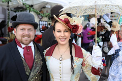 Dressed in Holiday Finery (wyojones) Tags: texas galveston dickensonthestrand christmas holiday festival victorian gentleman man guy hat vest suit thestrand tie bowler beard red woman lady beauty beautiful gorgeous lovely parasol lace dress necklace earrings smile greeneyes blueeyes brunette flower people couple two
