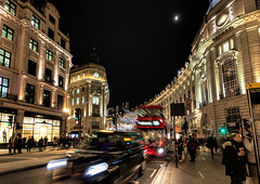 Vibrant and bustling shopping in Regent Street, London (Aethelweard) Tags: london england unitedkingdom gb street night time exposure longexposure buildings bus colourful motionblur taxi shopping beautiful efs1018mm