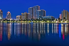 City of West Palm Beach, Palm Beach County, Florida, USA (Photographer South Florida) Tags: trumptowers westpalmbeach palmbeachcounty city cityscape urban downtown skyline southflorida density centralbusinessdistrict skyscraper building architecture commercialproperty cosmopolitan metro metropolitan metropolis sunshinestate realestate highrise royalparkbridge townofpalmbeach palmbeach clearlake bluehour longexposure