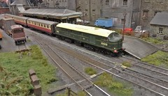 Diesel 10001 Stands at Hillhouse Station. (ManOfYorkshire) Tags: scale model transport exhibition show worksop 2018 lms britishrailways diesel 10001 pioneer early hillhouse station passenger train railway oogauge 176 bachmann