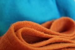 Orange and Blue (Argyro Poursanidou) Tags: macromondays cloth fabric orange blue macro curves color still life