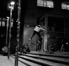 Skater in barça (max832) Tags: squareformat sooc jump stairsjump nightphotography macba barcellona microfourthirds 25mm18 micro43 omdem10mark3 streetphotography street blackwhite middleair skater