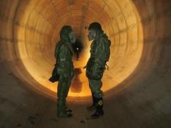 Explorers inside tunnel (CZDiver) Tags: gasmask gasmaske potichemickýoblek opch70 m10gasmask postapocalyptic postapocalypse abandoned abandonedplaces undergroundexploring urbex urbanexploring