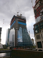 5 bank street gets its glass (n.a.) Tags: upright piano building bank street canary wharf heron quays e14 london construction cranes clouds