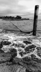 Rusty Pole (mysteriskandar) Tags: rockybeach longexposure milkywaves beach blackwhite waves