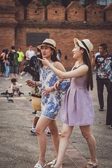 Attractive young women on holiday in Thailand (Mat Mayer) Tags: girls ladies women attractive fedora hats beautiful crowd thapae chiangmai thailand holidaymakers street jupiter8