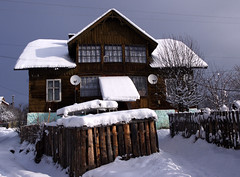 Ukraine/ Carpathians. House under the snow (videodigit16) Tags: landscape outdoor sky clouds village mountains hill vorokhta carpathians winter snow skiing tourizm recreation mountain nature image serene trees forest cold silence calmly tree plant picea moss mist wood road mountainside chalet building house window roof fence yard ukraine