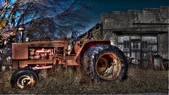 Tractor (Tim @ Photovisions) Tags: tractor fuji xt1 nebraska fujifilm junk building garage shed abandoned
