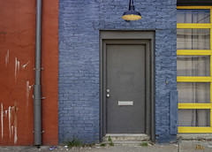 That Gray Doorway (The way Mike sees it) Tags: door entrance portal doorway red blue yellow urban colors