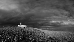 Dungeness Boat on Shingle Beach (Clare Havill) Tags: yellow red nikon d610 afs nikkor 2470mm f28g ed lens with dungeness shingle december landscape natural light romney marsh sea sky boat grass ocean bay water nikond610 nikonafsnikkor2470mmf28gedlens nikond610withnikonafsnikkor2470mmf28gedlens beach black white blackwhite clouds blackandwhite panoramic print panoramicstitch