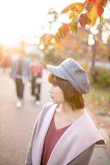 Young woman waiting in autumn public park (Apricot Cafe) Tags: ap2a3108 asia beautifulpeople japan japaneseethnicity kyotocity kyotoprefecture maruyamaparkkyoto millennialgeneration sigma35mmf14dghsmart autumn autumnleafcolor backlit beret coat colorimage copyspace elegance gion leisureactivity lensflare lifestyles loneliness lookingaway nature oneperson oneyoungwomanonly people photography publicpark relaxation relaxing selectivefocus serenepeople shorthair sideview standing street sunlight sunset tourism travel twilight waistup waiting women youngadult