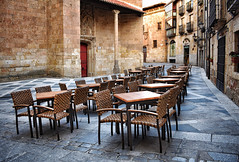 Empty Seats (Jocelyn777) Tags: streets architecture buildings tables chairs cobblestones salamanca spain travel monuments historiccitycentres historictowns