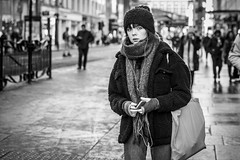 Winter Warmer (Leanne Boulton (Catching Up)) Tags: urban street candid portrait portraiture streetphotography candidstreetphotography candidportrait streetportrait eyecontact candideyecontact streetlife woman female girl face eyes expression mood feeling emotion cold winter weather beanie scarf wrapped warmth tone texture detail depthoffield bokeh naturallight outdoor light shade city scene human life living humanity society culture lifestyle people canon canon5dmkiii 70mm ef2470mmf28liiusm black white blackwhite bw mono blackandwhite monochrome glasgow scotland uk