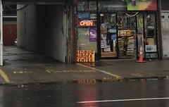 NYC SIDEWALK (SplashH2O) Tags: nyc newyork newyorkcity sidewalk signs storefront hardware hardwarestore street wet rainy alley alleyway bedbugs orangecone open opensign bedbugsign door doorway noparking realnewyork authentic real city urban water puddles reflection