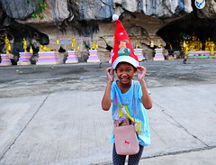 ,, Merry Christmas ,, (Jon in Thailand) Tags: theprincess red green blue gold themonkeytemple thaismile christmasconehat merrychristmas pink purple spiritcave jungle streetphotographyjunglestyle child nikon nikkor d300 175528 yellow streetphotography sillygirl