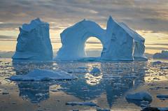 Iceberg window (loveexploring) Tags: baffinbay diskobay diskoisland greenland ilulissat westgreenland archediceberg arctic beautyinnature iceformation iceberg icebergwindow landscape midnightsun reflection sea seascape water