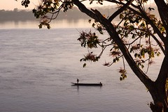 Peace and quiet (sudaratsudy) Tags: fisherman fishing boat morning mekong river mukdahan thailand landscape background early sunrise asia asian fish tropical outdoor lake water sunset argiculture sunshine goldenhour scenery light delta laos myanmar vietnam cambodia tree beautiful alone