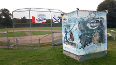 Baseball Park in Halifax, Nova Scotia (Coastal Elite) Tags: conrosepark minor baseball field halifax novascotia sports mural painted players empty diamond backstop flag flags canada canadian conrose park sport ballpark cincinnatireds logo urbanpark horsefield