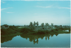(grousespouse) Tags: vietnam 35mm analog film nikonf3 nikonseriese 28mm f28 wideangle analogue landscape tombs hue asia bluefilter 80b tiffen reflection water aquarmar aqua aquamar kodakvision200t vision mood atmosphere colorfilm tungsten cinematic cinema