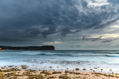 Overcast Morning at the Seaside (Merrillie) Tags: daybreak sunrise nature water macmasters centralcoast morning sea newsouthwales rocks earlymorning nsw dawn clouds ocean landscape cloudy waterscape coastal macmastersbeach outdoors seascape australia coast sky waves