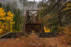 Bridge Over Wenatchee River (NikonDigifan) Tags: autumn autumncolors fall fallcolors bridge mountains cascades leavenworthwashington wenatcheeriver mist fog washington pacificnorthwest pnw