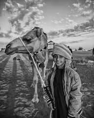 An Omani Bedouin boy poses for a picture with his camel. (j4h1ds) Tags: oman omannews sky ston sunrise shedow sigma nikon netional nightscape netgeotravel nikkor natural ngc nature flickrtravelaward focus action amazing arabian adobe animal architectur assembily alone rod j4h1ds journey kids explore european blue beauty black beach barka background naturalwaterfalls khaosan timesofoman