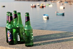 There's no drinking after you're dead... (modestino68) Tags: bottiglie bottles barche ships mare sea muro wall paulweller