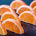 Marmalade orange slices on black background