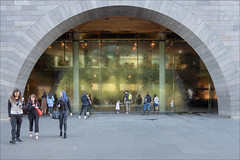 melbourne-1388-ps-w (pw-pix) Tags: arch curve curves reflection glass water waterwall waterfall wet men women children boys girls playing looking touching photographing people walking groups couples exterior interior lights wood panelling strips pillars supports paved paving grey stone gallery art artgallery ngv nationalgalleryofvictoria sundayafternoon warm spring stkildaroad melbourne victoria australia peterwilliams pwpix wwwpwpixstudio pwpixstudio