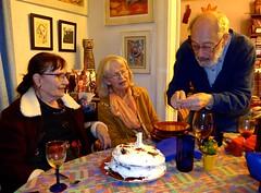 Bob lighting the candle on Edith's birthday cake (ali eminov) Tags: wayne nebraska celebrations birthdays edithsbirthday food cakes raspberrychocolatecake friends janet bonnie bob