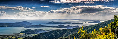Coromandel Peninsula - New Zealand (Bobinstow2010) Tags: newzealand blue sea clouds islands coromandel peninsula forest pano township godrays northisland