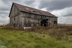 Abandoned but not Forgotten (NormFox) Tags: barn canada clouds farm grass landscape oldbarn ontario rural rust abandoned stclair ca