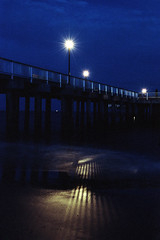 Pier (Rafakoy) Tags: nikonf6 afsnikkor2470mmf28g 50mm kodakportra100t c41 newyork brooklyn coneyisland water lights night beach longexposure film 35mm tungsten city urban colors negative epsonperfectionv600 epson v600 expired