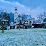 Holy Cross parish church with first snow in Kiefersfelden, Bavaria, Germany thumbnail