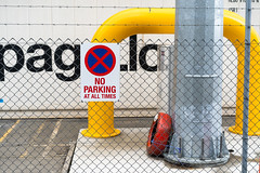 No Parking, Port Chalmers, Dunedin, New Zealand, 10.42 AM Sun. 2 Dec. 2018 (mark_mcguire) Tags: sonya7iii sony55mm dunedin dunedinnz otago newzealand nz candid streetphotography canpubphoto portchalmers portdpsnz noparking sign yellow red blue tire tyre