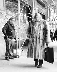 See the man on the corner (mkc609) Tags: street streetphotography bw blackandwhite blackwhite urban candid nyc newyork newyorkcity furcoat