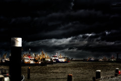 Storm And Thunder? (Alfred Grupstra) Tags: harbor sea night industry commercialdock freighttransportation nauticalvessel transportation cargocontainer water cloudsky industrialship sky pier dark ship shipping oilindustry nopeople craneconstructionmachinery storm thunder