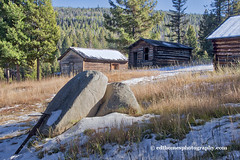 cabin and boulders 2crpd_3356 (Ed Thomes Photography) Tags: garnet ghost town montana missoula county mining gold rush buildings snow boulders rock blue sky pine trees ponderosa winter autumn history boom