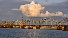 Railway bridge (©Andrey) Tags: riga railway bridge clouds day summer sun water reflection blue colours aqua sky daugava river rix lv lettonie landscape latvia a7rii sel55f18z sonnartfe1855